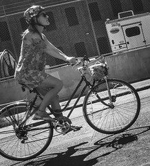 Easy Riding (TMimages PDX) Tags: iphoneography photography image photo photograph streetscene fineartphotography geotagged people urban city street streetphotography portland pacificnorthwest sidewalk pedestrians buildings avenue road blackandwhite monochrome vignette