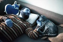 film (La fille renne) Tags: film analog lafillerenne 35mm canonae1program 50mmf18 lomography lomochrome lomochrometurquoise lomochrometurquoisexr100400 turquoise man sleeping portrait cat blue home cuddle