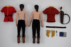 Deluxe vs Designer Gaston 12 Inch Dolls - Bodies and Outfits - Lying Down - Full Rear View (drj1828) Tags: us disneystore dfdc heroesandvillains disneyfairytaledesignercollection 2016 gaston purchase deboxed deluxedollgiftset beautyandthebeast comparison undressed outfits