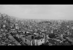 Gray Day (Zagros.os) Tags: city sky urban bw lebanon bird buildings view traffic smoke gray dust population tripoli depressing
