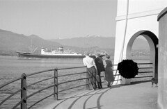 [People watching ship in harbour from Brockton Point]