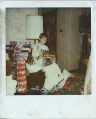 polaroid of me on christmas in the 80's (timp37) Tags: christmas xmas man polaroid toys tim transformers presents 80s pac