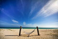 Bahamas Hammock (Nick Mulcock) Tags: blue sky net beach water sand day waves wind dunes wide relaxing grand swing clear crisp hammock bahamas tranquil bahama curise hammok tirquoise pwpartlycloudy