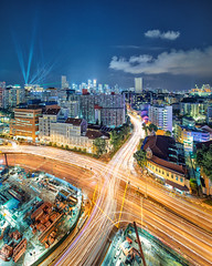 Xelectrik [Explored] (Scintt) Tags: show road street city travel light sky urban panorama india skyline architecture night clouds buildings evening construction singapore long exposure glow cityscape slow traffic little trails dramatic headlights junction vehicles shutter multiple exploration stitched guthrie bugis scintillation vertorama scintt