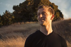 Alex (lordgogurt) Tags: people person face portrait figure being body life boy man male guy dude outdoor outdoors nature hill hillside seasons summer sunlight daylight light lighting dusk sunset evening grass field meadow sky look tree trees smile expression emotion happy laugh