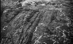 rock formations, into the sun, surf, foam, Pemaquid Point, Maine, Mamiya 645 Pro, Ilford HP4+, R5 Monobath Developer, 8.24.16 (steve aimone) Tags: rocks rock surf foam pemaquid pemaquidpoint maine midcoast monochrome monochromatic mediumformat 120 film mamiya645pro mamiyasekkor80mmf28 ilfordfp4 r5monobathdeveloper blackandwhite landscape intothesun
