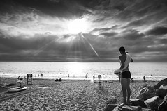 The Boy at the Beach (Explored) (Ludo_Jacobs) Tags: beach boy monochrome blackandwhite sky clouds sun strand france frankreich street streetphotography candid panasoniclumix
