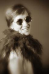 Patricia (giltay) Tags: topw topwppl torontophotowalks torontophotowalksportraitsandpotluck patricia blackandwhite blackwhite sepia lensbabyspark lensbaby lensbabyglasssingletoptic sunglasses featherboa portrait