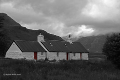 The Black Rock Cottage (sopwell287) Tags: noiretblanc bw blackrockcottage glencoe colourpop mono monochrome blackandwhite blacknwhite scotland cloud hills red cottage sony a200 unlimitedphotos old highlands glenetive