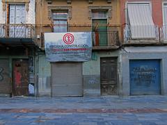 streets of cartagena (maximorgana) Tags: cartagena plazadesanfrancisco plazasanfrancisco sanfranciscosquare enconstruccion trashbit shutter persiana balcony door wire derelict abandoned