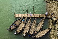 Boats and boatmen (Aranya Ehsan) Tags: boat boatman river pov bangladesh canon people life lifestyle dailylife water dhaka