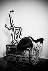 Pent up (Spectral Convergence) Tags: bw woman hair blackwhite pants trunk heels pinup strobist