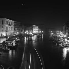 My silent night (Arianna_M (busy)) Tags: longexposure venice light sea bw moon black water fog night reflections lights shadows darkness luna bn ombre silence ghosts luci lighttrails acqua venezia notte rialto commongrounds oscurit pontedirialto lungaesposizione mynight biennalediarchitettura2012 alphasonydslr350