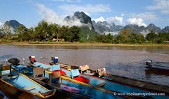 Along the Nam Song river - Vang Vieng, Laos (My Planet Experience) Tags: voyage trip travel mountain tourism canon river boat photo colorful asia southeastasia riverside photos pics picture asie laos karst vangvieng stockphotography namsong  lo  asiesudest   landofamillionelephants    wwwmyplanetexperiencecom myplanetexperience