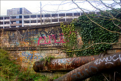 Downmarket Area (Canis Major) Tags: abandoned bristol graffiti pipes rusty downmarket parcelforce