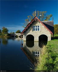 The Boathouse (bbusschots) Tags: bridge autumn ireland lake reflection history filter boathouse maynooth circularpolarizer kildare localhistory historicbuilding cartonestate