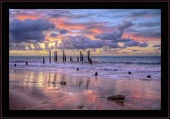Aldinga beach (J-C-M) Tags: sunset seascape reflection beach water clouds landscape evening pier high sand nikon colours dynamic south sandy australia adelaide colourful d200 pylons range southaustralia hdr stumps seawater mclarenvale aldinga aldingabeach