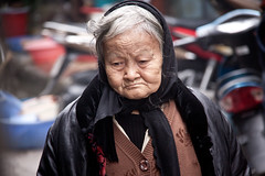 Candid Street Portrait of an Elderly Vietnamese Woman - Hang Da Market - Hanoi, Vietnam (ChrisGoldNY) Tags: chrisgoldny chrisgold chrisgoldberg chrisgoldphotos chrisgoldphoto forsale posters poster albumcover albumcovers bookcover bookcovers vietnamese viet vietnam northvietnam hanoi travel viajes gridskipper jaunted indochina asia asian southeastasia women people portraits candid canon elderly old woman street streetscenes hangda city urban faces aged wrinkles greyhair vn thechallengefactory unanimous challengefactory challengewinners friendlychallenges postcards life warmth alive greetingcards
