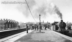 M996-00067 (railphotolibrary.com) Tags: old england people urban building english station train town europe buckinghamshire travellers platform archive railway historic steam passengers busy lamps aylesbury lner bw1 uk1
