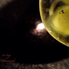 in a marble eclipse (green-dinosaur) Tags: abstract art glass yellow colours close theme marbles 365 challenge app iphone macrolens twitter sooc digitalcameraworld iphone4 iphoneography lifeinlofi theinspirationgroup suefagg wearejuxt sooic theappwhisperer
