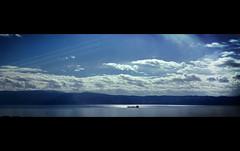 Magic light from heaven (VillaRhapsody) Tags: blue light sea clouds boat driving ship istanbul beam rays seaofmarmara challengeyouwinner