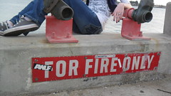 Throne of Fire (Caliwow) Tags: feet water sign metal warning outside grey cool dock hand stickers cement jeans booty converse lounging curb firedepartment enjoyment pondering seaportvillage whiteshirt model5 chillingout blackvest fireprevention relazed fireonly waternozzles