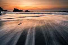 Kawazu Sunrise (arcreyes [-ratamahatta-]) Tags: longexposure seascape beach nature japan sunrise landscape gold spring rocks waves coastline izu goldenhour kawazu 2013 nikkor1424 arcreyes d800e