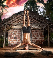 Wide Arm headstand of Hawah near fisherman hut at sunset in India. Photo by Alex and Marina Photography.