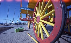 Big Wheel , Tiny People (4foot2) Tags: bigwheel tinypeople smallpeople candidportrate candid streetphoto streetshot street streetphotography reportagephotography reportage people peoplewatching peopleofbrighton interestingpeople brighton seafront seaside promenade analogue film filmphotography 35mmfilm 35mm printfilm oldfilm outofdatefilm expiredfilm experimental fujifilm reala500d zorki1 zorki rangefinder 15mm voigtlander15mm voigtlander superwideangle closeup close remjet remjetremoval washingsoda ecn2 lightleaks 2016 fourfoottwo 4foot2flickr 4foot2photostream 4foot2