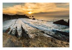 La-arnia-1 (diegogonzlezvilda) Tags: playa costa paisaje mar cantabria cielo sol nubes atardecer composicion nikon sigma rocas olas