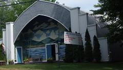 NH Boat Museum - IMGP5441 (catchesthelight) Tags: wolfeboro nh summer boating lakesregion vintageboats races 1933 newengland charm quonsethut historic nhboatmuseum roadside travel decofacade mural allenaresort