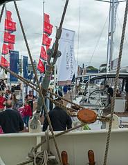 Hustle and Bustle (Reinardina) Tags: southampton england boatshow boatshow2016 boat ship sail ropes pulley people hustleandbustle windy breeze flags