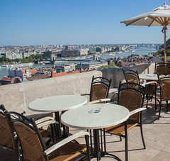 Lunch at Buda Castle (Benjamin Gillet) Tags: city urban bar table landscape lunch restaurant town pub hungary view budapest tables vue buda pest chaise chaises djeuner magyarorszg hongrie varos