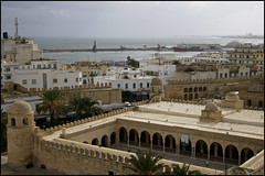 the grand mosque of sousse, tunisia ..... (ana_lee_smith) Tags: africa old travel houses sea tourism lens photography coast town sandstone mediterranean minolta harbour tunisia minaret north columns photojournalism courtyard mosque east beercan dome medina af northern sousse fortress susa watchtower walled fortified 70210mm ribat porticos thegrandmosque gulfofhammamet analeesmith 9thc sonyslta33 legrandmosquedesousse