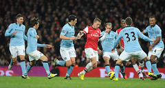 Lukas Podolski crowded out by the Man City defence (Stuart MacFarlane) Tags: england london football unitedkingdom soccer arsenal manchestercity gbr arsenalfc premierleague manchestercityfc clubsoccer englishpremierleague englishsoccerleague