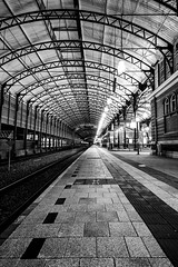 Hollands Spoor (Architecture/Night) (Mark Kerkhoff) Tags: camera longexposure bw building monochrome station architecture night train canon blackwhite publictransportation zwartwit railway arches denhaag tokina thehague trein spoor openbaarvervoer denhaaghs hollandsspoor