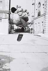 Skateboarding, Ljubljana (Karlovcec) Tags: bw newyork film canon skateboarding skaters ljubljana a1 filmcamera canona1 ilford kodak400 newyorkstreet xp2super