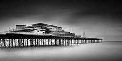 Apocalyptic Holiday (Colwyn Bay Pier) (Anthony Owen-Jones) Tags: ocean uk longexposure sea sky blackandwhite bw cloud white seascape black art water monochrome wales architecture clouds canon landscape eos rebel mono bay coast landscapes pier photo seaside kiss europe long exposure moody artistic unitedkingdom fineart north picture minimal filter photograph le ethereal nd postprocess minimalist bnw conwy t3i x5 rhosonsea colwynbay northwales rhos colwyn sep2 600d takenwith 10stop nd110 rebelt3i kissx5 anthonyowenjones anthonyowenjonescom