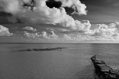 Clouds. (jackson England) Tags: ocean black clouds lymeregis whitesky