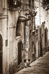 Perugia Street (Robert Greatrix) Tags: street old blackandwhite bw italy sepia contrast children restaurant europe sony chinese streetshots streetphotography sigma cobblestone perugia 70200 umbria sonycamera streetshot sepiatoned copyrighted streetphotographer travelphotography canadianphotographer streetphotograph sigma70200 travelphotograph torontophotographer travelshots travelshot ontariophotographer sonyalpha sonydlsr robertgreatrixphotography copyright2013