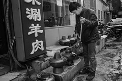 Preparing for Hot Pot (Russ Beinder) Tags: china street hot cn market candid chinese beijing pot coals 0mmf0