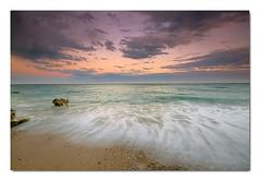 serenidad (natalia martinez) Tags: sunset azul relax atardecer mar agua paz nubes rocas sedas