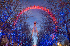 The Eye at Night (adrians_art) Tags: london eye londoneye ferriswheel ride uk england city urban structures pods nighttime sky clouds lights trees fairylights waterloo southbank riverthames plants gritty grit curves circles light dark
