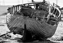 Sad end. (pstone646) Tags: boat blackandwhite monochrome decaying shore wreck broken dungeness kent