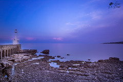 il faro solitario (lulo92) Tags: tramonto fao luc ligth sunset sunrise cloud clouds nuvole otranto lecce puglia viola purplu purple blu nuvoe samyang longexpositure lungaesposizione capture landscapes seascapes sea scogli rock wooow