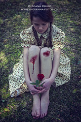 wounded knees (Ticino-Joana) Tags: red flower feet nature floral girl beautiful grass childhood rose female outside outdoors person foot spring pain hurt blood pretty sitting child sad dress legs cut wounded leg crying lawn young injury meadow sit barefoot barefeet braids bloody knees bleeding vernal knee wound desolate unhappy springtime injured dolorous caucasian springlike doleful barefooted cheerless lesion unshod shoelss