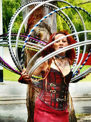 My Head is Spinning! (Steve Taylor (Photography) Internet V slow) Tags: red newzealand christchurch tattoo key canterbury rings nz corset hoolahoop southisland entertainer hoops performer gypsy hulahoop impressedbeauty flickrdiamond neckbelt