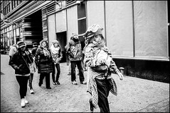 Woman With Unusual Headdress (Roberto Novicini) Tags: nyc calle manhattan streetphotography hc110 contaxt3 hellskitchen 42ndstreet pabt foma fomapan dilutionb fomapan400 stphotographia