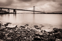 Forth Road Bridge at Dusk (Wan ~stuck in catch up loop) Tags: longexposure bridge water rocks dusk silky forthroadbridge lightedbridge sigma1020mmdchsm nikond7000 wmekwiphotography mekwicom