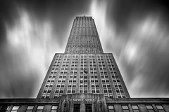 Empire (Tim Drivas) Tags: city nyc newyorkcity longexposure blackandwhite newyork architecture clouds skyscraper canon cityscape manhattan midtown empirestatebuilding gothamist hdr cloudmovement